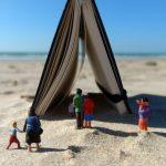 miniature figures, beach, notebook